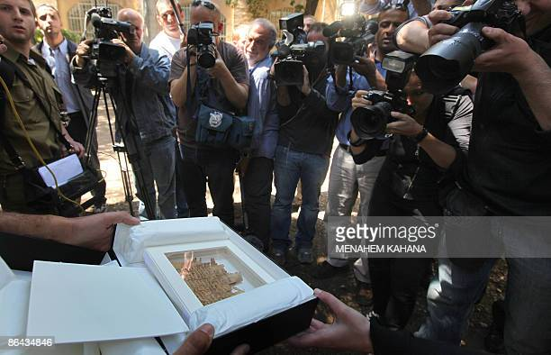 Photographers take pictures on May 6 2009 of a 2000yearold papyrus document found by Israeli authorities in Jerusalem Israeli authorities have...