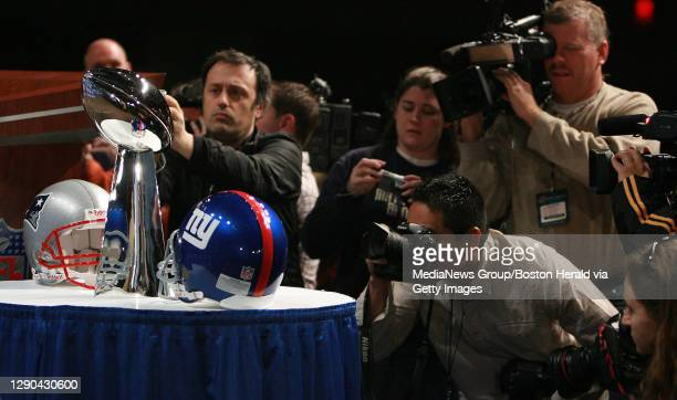 Photographers take their best shot of the Lombardi trophy at Superbowl XLII HQ at the convention center. Friday, February 1, 2008. Staff Photo by...