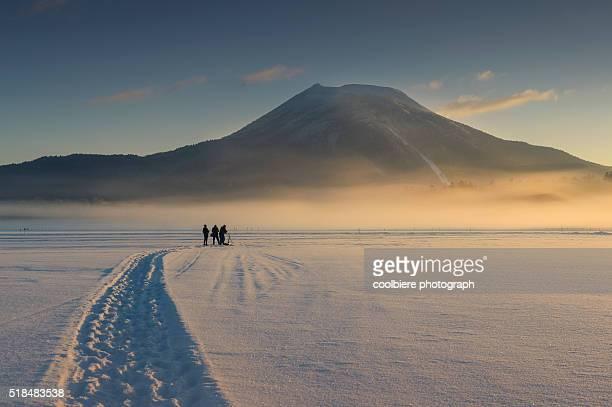 photographers taking photo of Lake Akan winter landscape