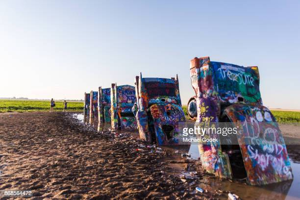 Photographers taking pictures of popular Cadillac Ranch installation