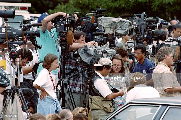 Photographers television crews and reporters set up on July 31 in Atlanta outside the apartment of Richard Jewell a security officer who is being...