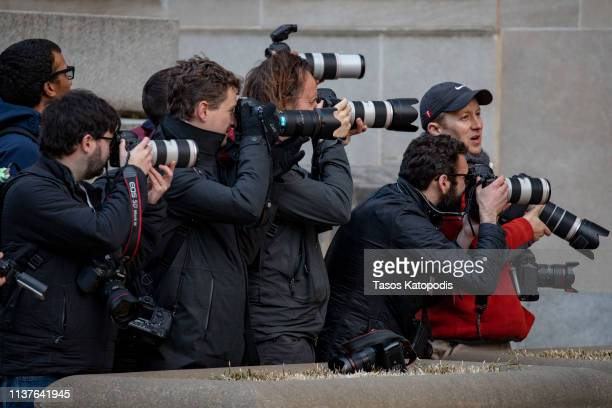Photographers try to get a view at the the Department of Justice on March 22 2019 in Washington DC Special counsel Robert Mueller has delivered his...