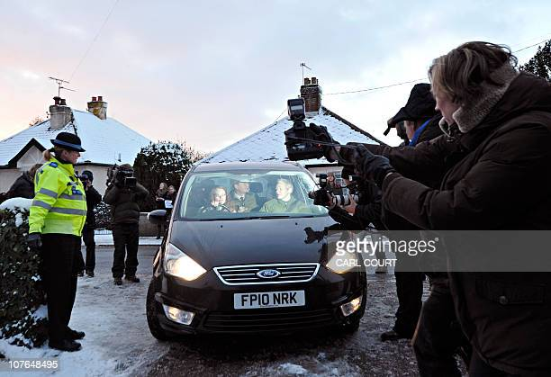 Photographers try to get pictures of WikiLeaks founder Julian Assange as he arrives at Beccles police station in Suffolk eastern England on December...