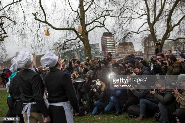 Photographers try to organise a photograph ahead of the annual Parliamentary Pancake Race in Victoria Tower Gardens on Shrove Tuesday on February 13...