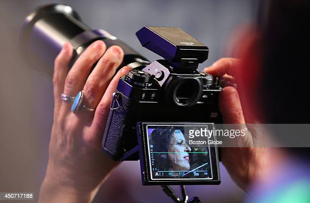 A photographer's viewfinder shows candidate for governor Juliette Kayyem making her speech at the Democrat State Convention at the DCU Center in...