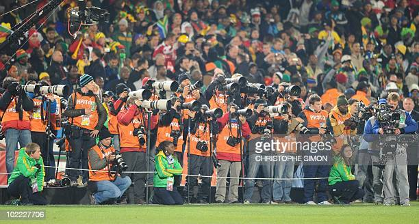 Photographers wait for the start of the 2010 World Cup group E first round football match between Denmark and Cameroon on June 19 2010 at Loftus...
