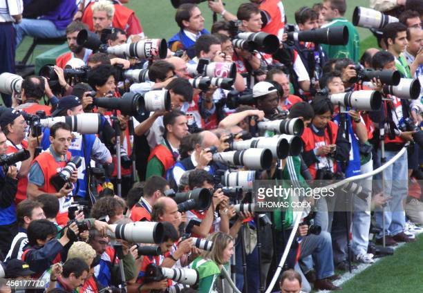 Photographers wait for the start of the Soccer World Cup semifinal match between France and Croatia 08 july at the Stade de France in SaintDenis...