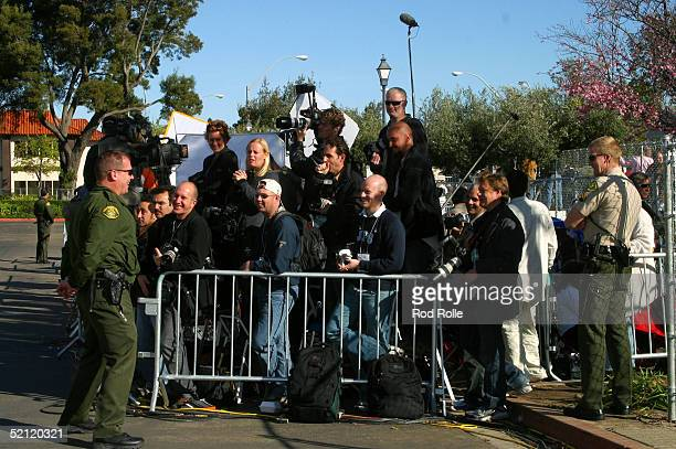 Photographers wait in a media pen for singer Michael Jackson to arrive at the Santa Barbara Superior Courthouse for the second day of jury selection...