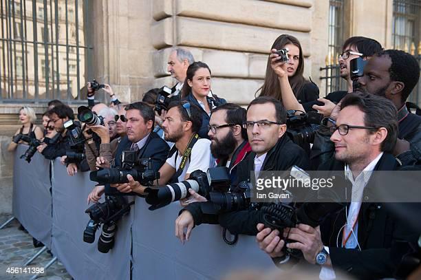 Photographers wait outside before the Christian Dior show as part of the Paris Fashion Week Womenswear Spring/Summer 2015 at Cour Carree du Louvre on...