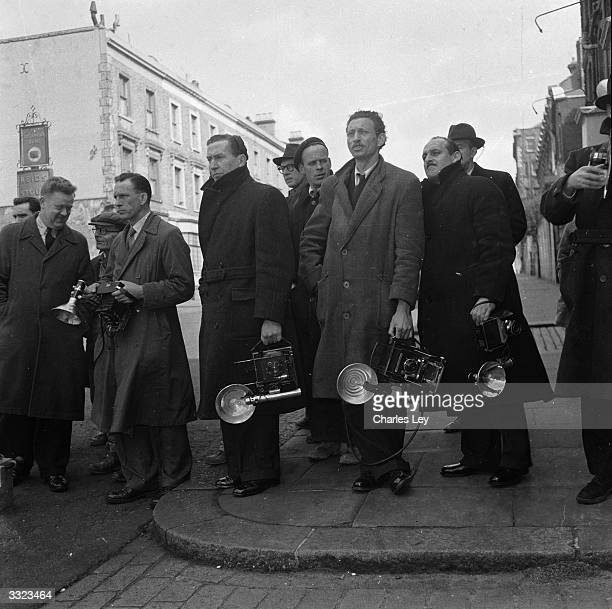 Photographers wait outside the courtrooms for the arrival of murderer John Reginald Halliday Christie in Notting Hill London