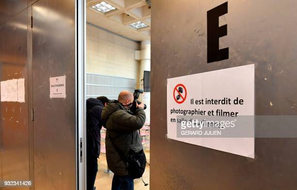 Photographers work in a courtroom in Nanterre on March 15 where the two older children of iconic French musician Johnny Hallyday are scheduled to...