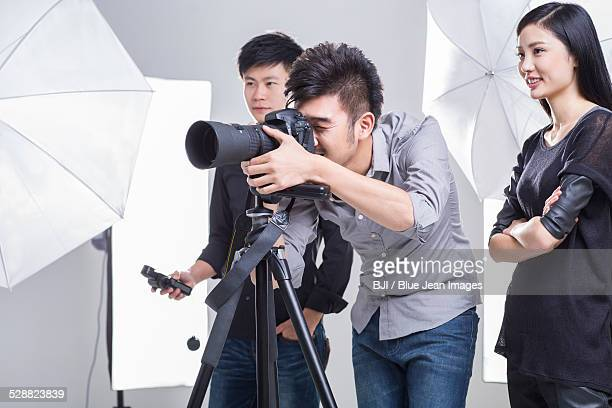 Photographers working in studio