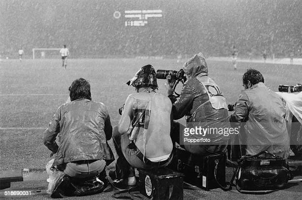 Photographers working in the rain during the World Cup second round match between Argentina and the Netherlands at the Parkstadion Gelsenkirchen...