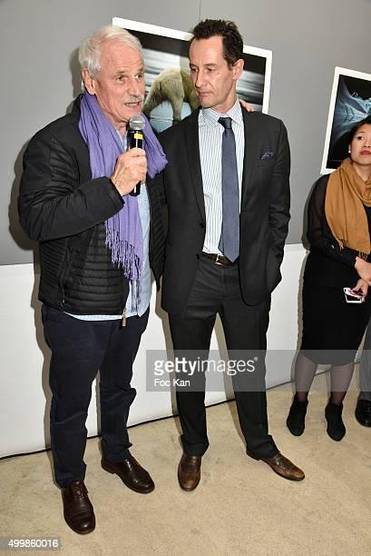 Photographers Yann Arthus BertrandÊand Sebastian Copeland attend the 'Artica Vanishing'Êat Galerie Yann Arthus Bertrand on December 3 2015 in Paris...