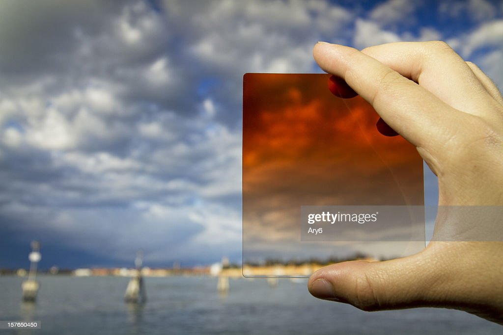 Photographic  equipment  in the hand (filter) on Venice background : Stock Photo