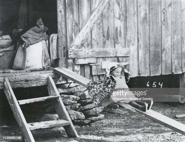 Photographic mock-up for an Alfred Stanley Johnson photomontage postcard entitled 'Shooting the Shoots,' Waupun, Wisconsin, 1913. A small girl is...