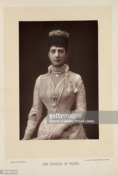 A photographic portrait of Alexandra Princess of Wales taken by W D Downey The princess appears in formal royal costume and appears to be holding a...
