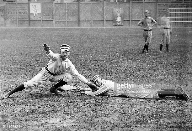 Photographic portrait of two baseball players from the Philadelphia Quakers, Arthur Irwin is pretending to tag out Tommy McCarthy who is pretending...