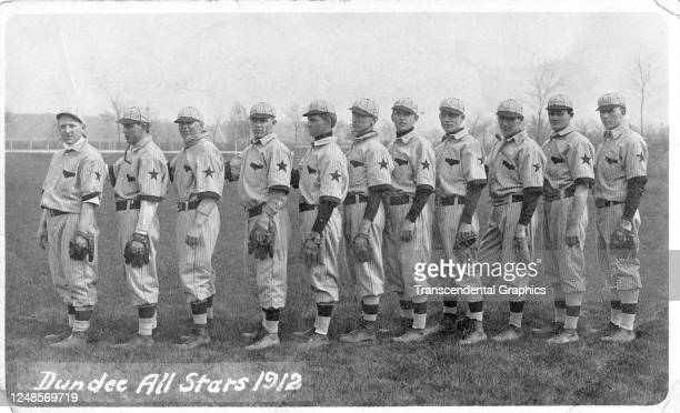 Photographic postcard features a portrait of the members of the Dundee All Stars baseball team as they pose in a line Dundee Illinois 1912