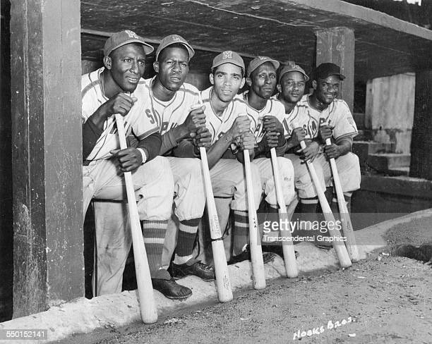 Photographic print by the Hook Brothers of a group of Cuban baseball players from the Negro League Red Sox in the dugout together during a home game,...