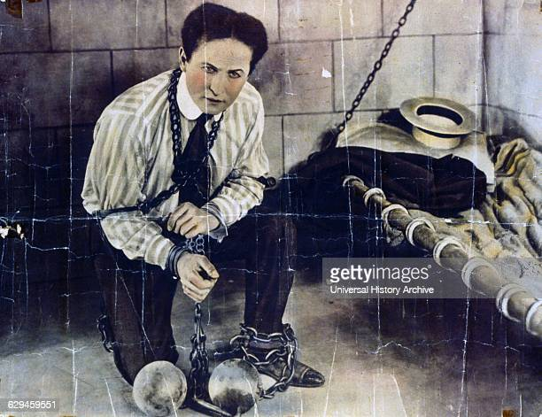 Photographic print hand coloured poster format of Harry Houdini a HungarianAmerican illusionist and stunt performer noted for his sensational escape...