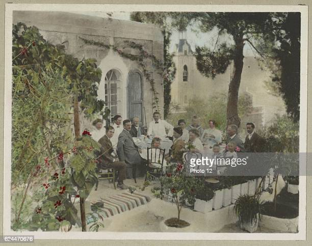 Photographic print handcoloured showing families belonging to the American colony in Palestine circa 1900