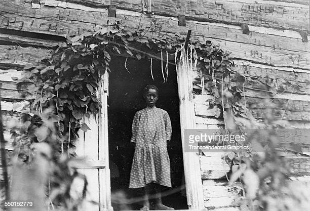 Photographic print of a black girl the door of a sharecropper's shack, Roanoke, Virginia, circa 1900.