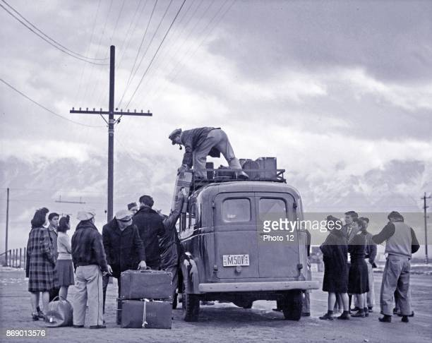 Photographic print of a loading bus leaving Manzanar for relocation Manzanar Relocation Centre California Photographed by Ansel Adams Dated 1943