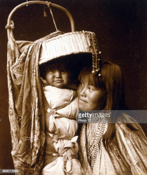 Photographic print of Apache girl and Papoose photographed by Edward Sheriff Curtis American ethnologist and photographer of the American West and of...
