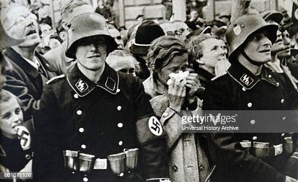 Photographic print of Austrian civilians standing behind an SS trooper during Germany Occupation of Austria during the Second World War Dated 20th...