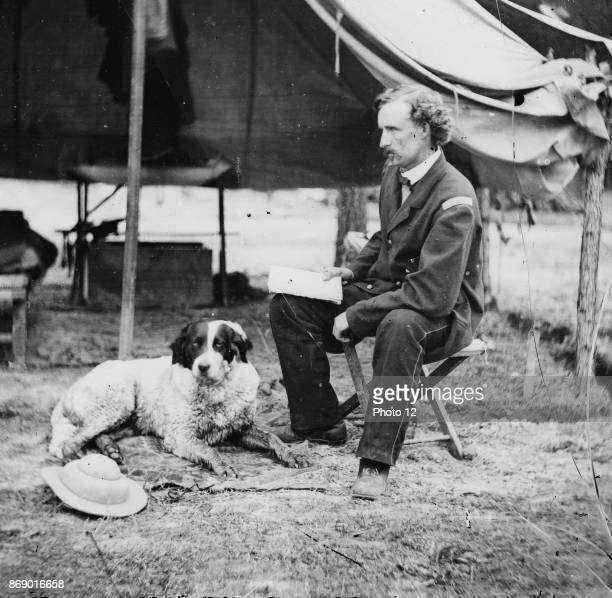 Photographic print of Cavalry Commander George Armstrong Custer with his dog during the American Civil War Raised in Michigan and Ohio Custer was...