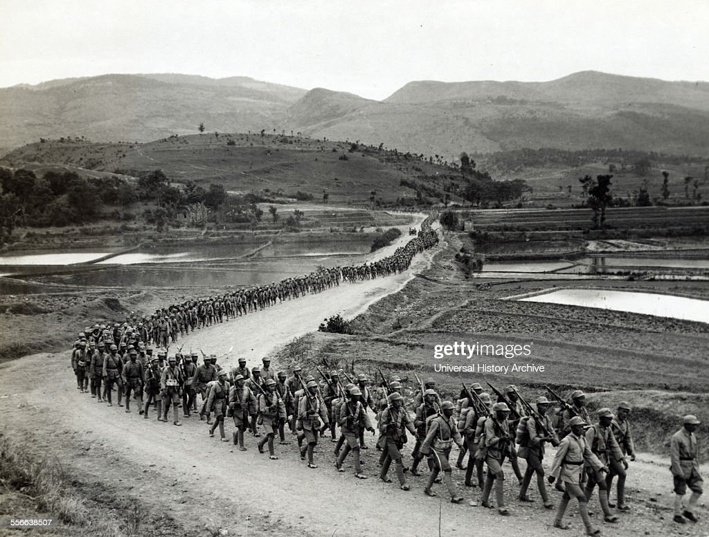 Photographic print of Chinese soldiers marching on road in Burma. Road heading toward the Salween front during the Burma Campaign in the South-East Asian Theatre of World War II. Dated 1943. : News Photo