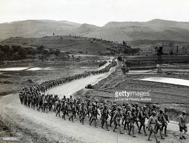 Photographic print of Chinese soldiers marching on road in Burma Road heading toward the Salween front during the Burma Campaign in the SouthEast...