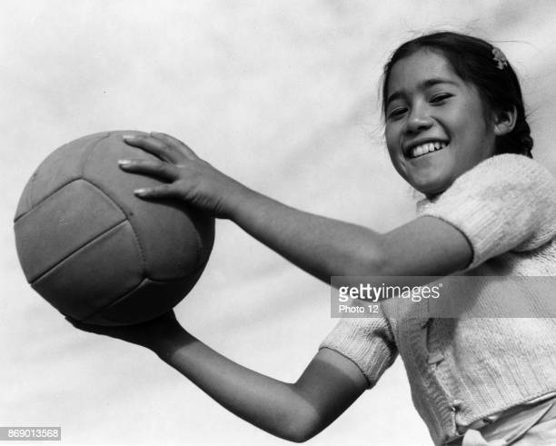 Photographic print of girl with volley ball at the Manzanar Relocation Centre California Photographed by Ansel Adams Dated 1943