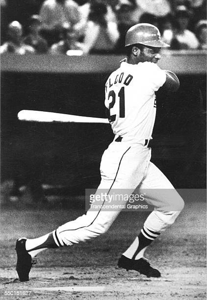 Photographic print of the baseball pioneer Curt Flood, who brought the game free agency, hits a line drive up the middle during a game at Busch...
