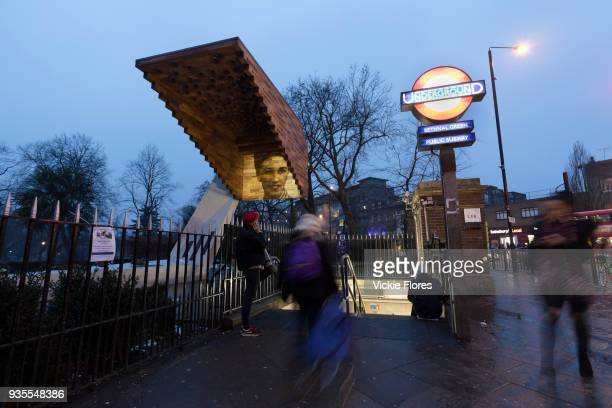 Photographic projections of the victims of the Bethnal Green tube disaster are projected onto the Stairway to Heaven memorial next to the Bethanal...