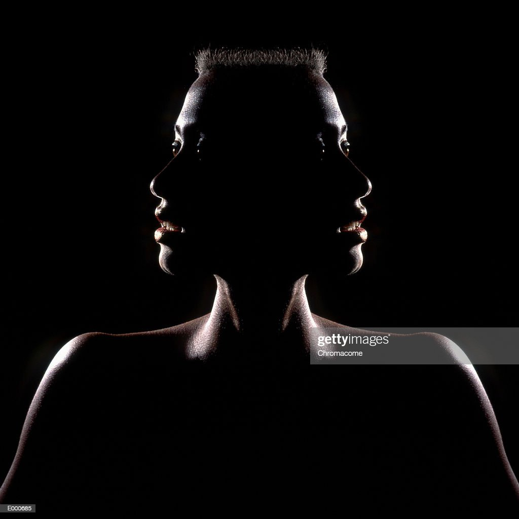 Photographic treatment showing woman with two faces : Stock Photo