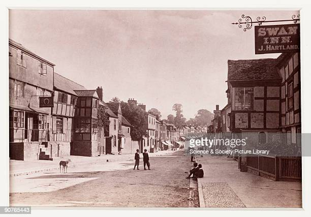 A photographic view looking down Homend Street in Ledbury Herefordshire with the Swan Inn on the right published by Francis Bedford Co Bedford was a...