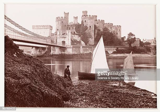 A photographic view of the suspension bridge leading to Conwy Castle in North Wales published by Francis Bedford Co Construction of the castle began...