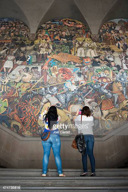 photographing a diego rivera mural in mexico city - national palace mexico city stock pictures, royalty-free photos & images