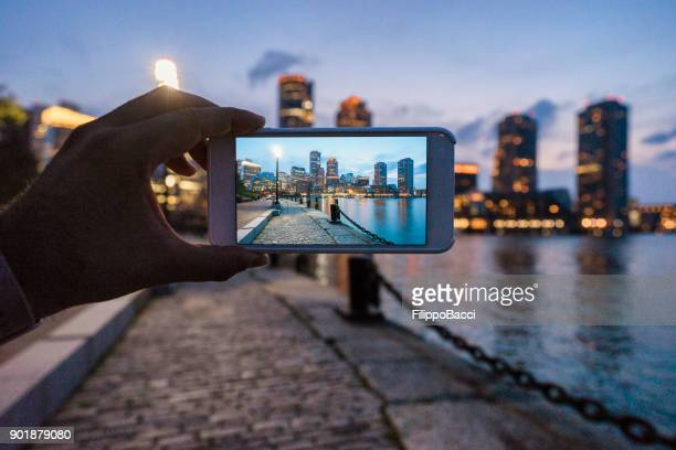photographing boston skyline at sunset - photographing stock pictures, royalty-free photos & images