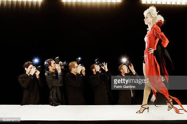 photographing model at fashion show - fashion runway stock pictures, royalty-free photos & images