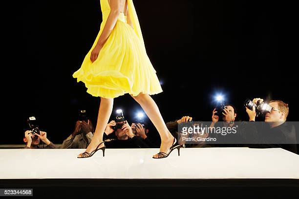 photographing model at fashion show - catwalk stock pictures, royalty-free photos & images