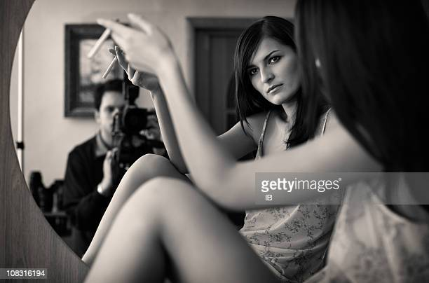 Photographing the beautiful model in front of a mirror