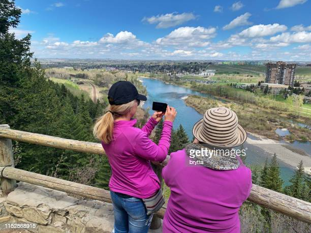 photographing the view during a hike, calgary,canada - bow river stock pictures, royalty-free photos & images