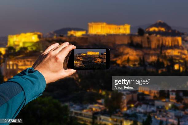 Photographing with smartphone in hand. Athens, Greece