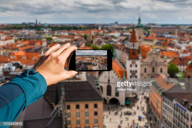 Photographing with smartphone in hand. Travel concept. Munich, Germany