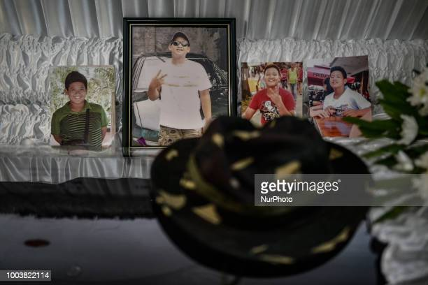 Photographs adorn the coffin of 14yearold Sean Christian Martinez who according to police was killed in a shootout with police officers at his...