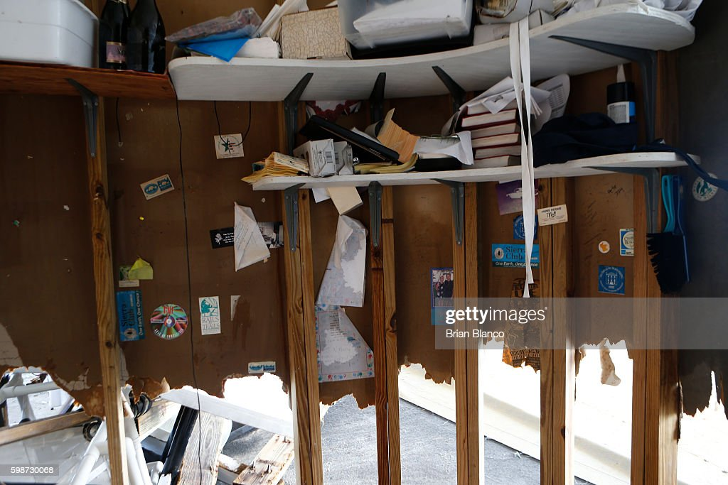 Photographs and books sit on what is left of the saltwater-soaked drywall inside the bar office area of the Cedar Cove resort after being damaged by the winds and storm surge associated with Hurricane Hermine which made landfall overnight in the area on September 2, 2016 in Cedar Key, Florida. Hermine made landfall as a Category 1 hurricane but has weakened back to a tropical storm.