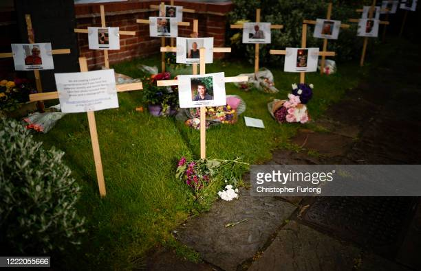 Photographs and memorials for those who died during the lockdown sit outside Riverside Church on April 30, 2020 in Burton-on-Trent, England. The...